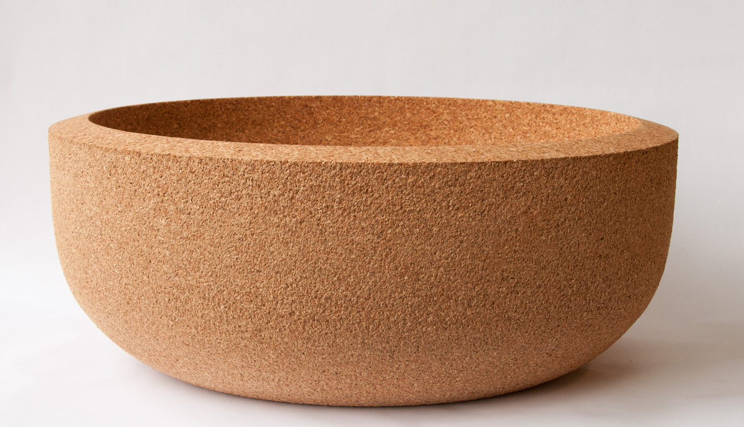 "Bacia Grande     A cork bowl on a massive scale! At over 24"" in diameter and 10"" high, this bowl will add drama as well as functionality to any table top. Hand washable.  SHOP"