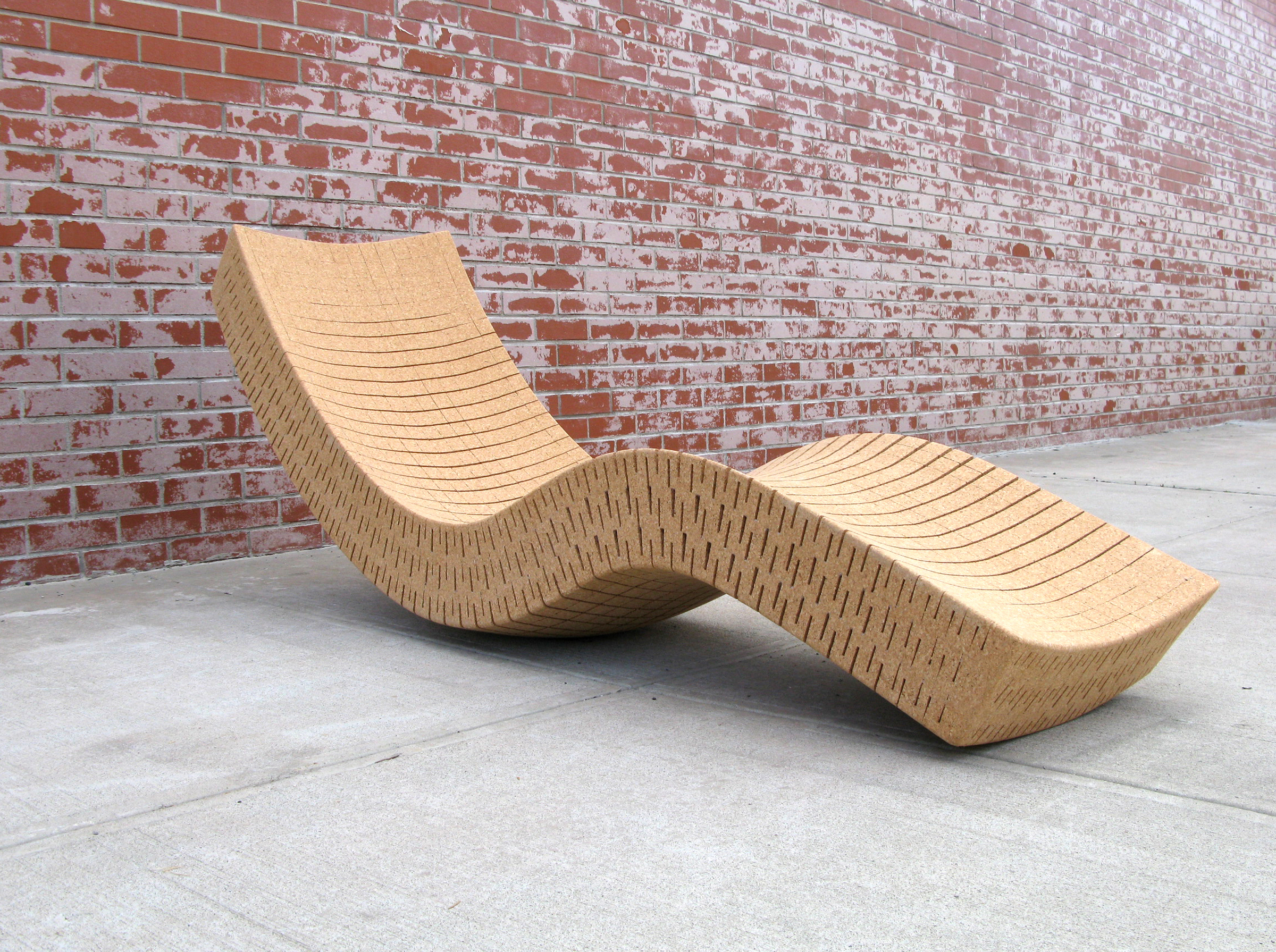 "Cortiça chaise longue    26"" H x 20"" W x 74"" L. 100% Recycled Cork  Handmade to order, this full size chaise lounge allows for gentle rocking both side to side and front to back, providing a sense of effortless floating.  Suitable for indoor/outdoor use. Standard wait time is 6-8 weeks.  SHOP"