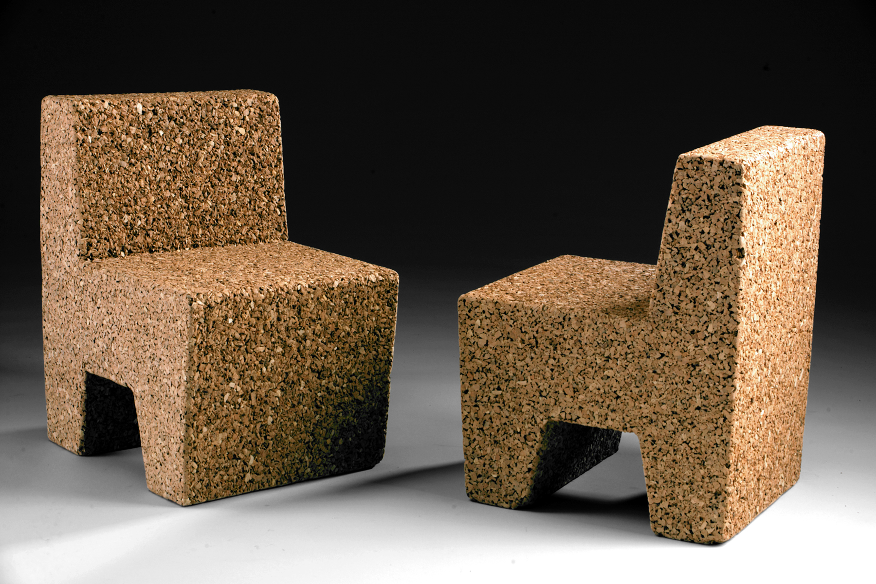 "Cub children's chair - 2005   18""H x 13""W x 13""D - Hand-cast recycled cork  This small chair is the result of our studio experiments into casting recycled cork. A single volume formed from granulated corks, these children's chairs have a smooth, sanded texture on the sides and a rough, engaging texture on the front and back.  Indoor use only. Available by custom order."