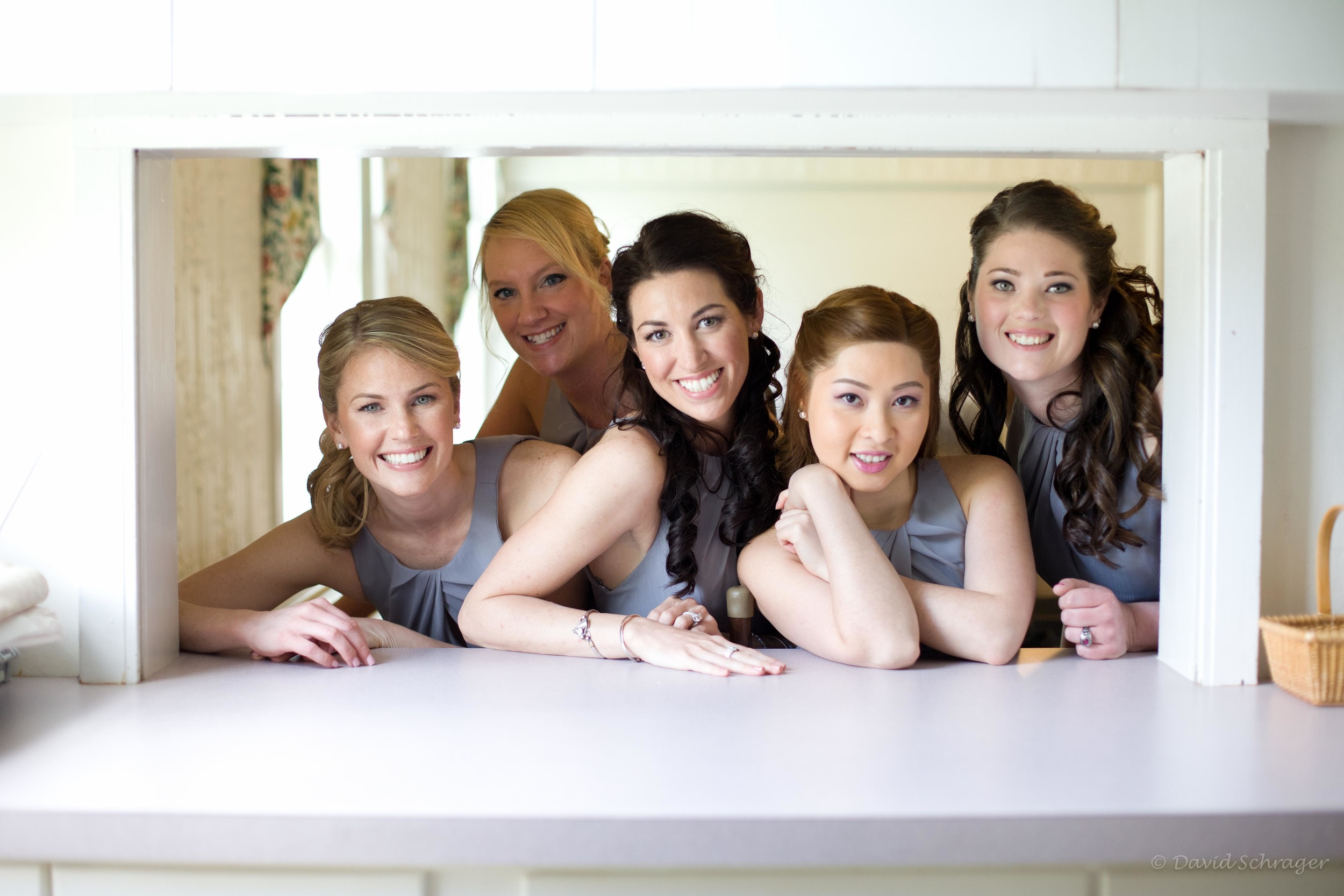 The bridesmaids had some fun while Lauren got into her dress,posing for photos in the spacious church kitchen.