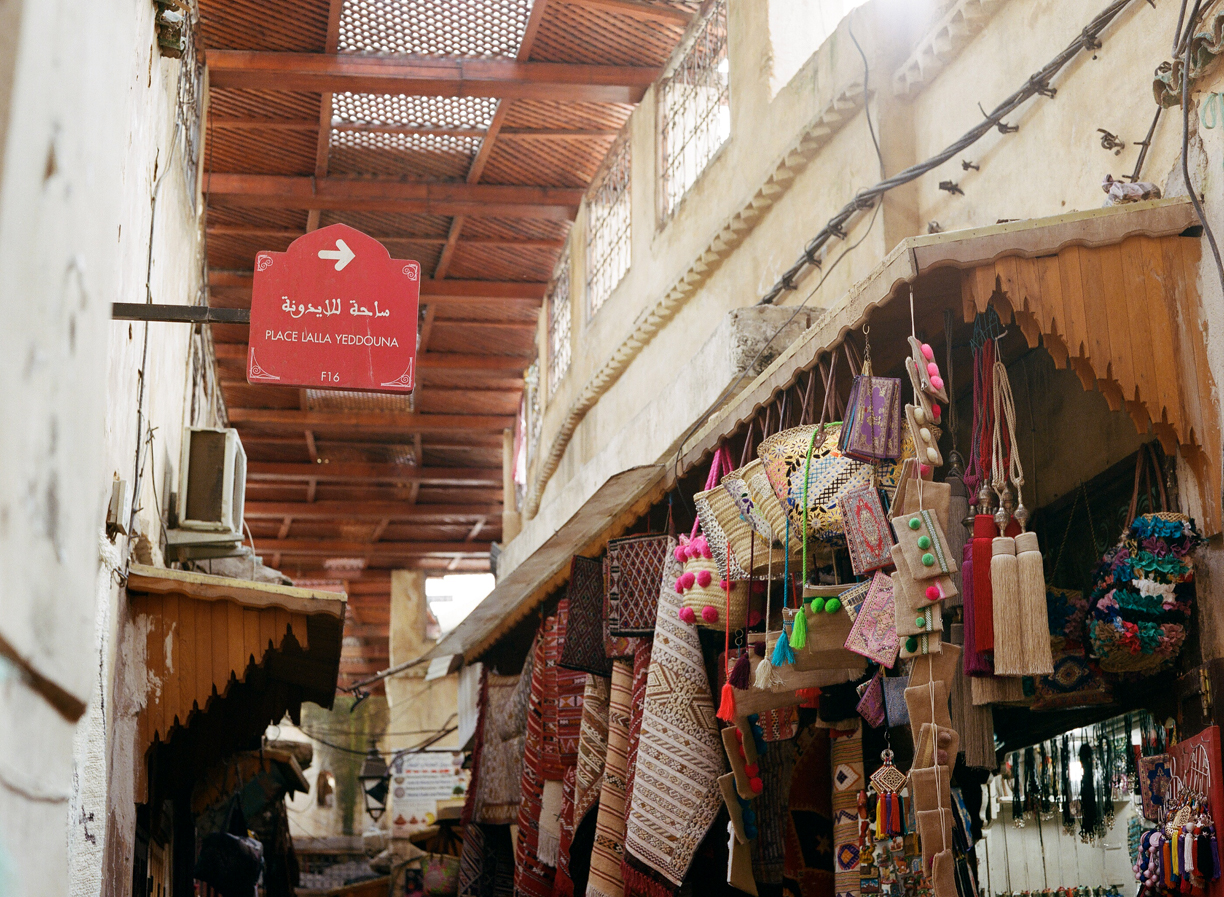 Fez medina sign_bags and rugs_web.jpg