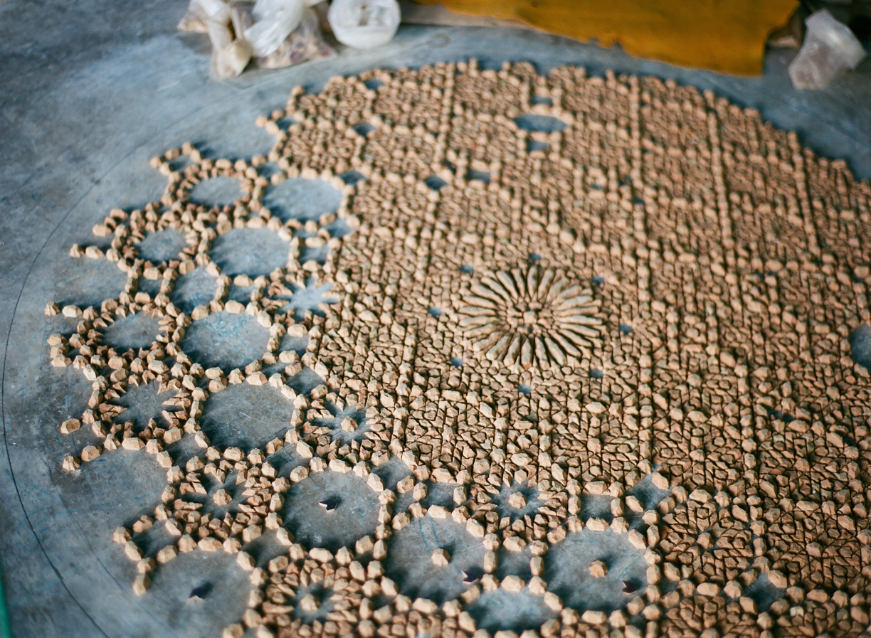 tile pieces laid out in circle on floor_fez co-op_web.jpg