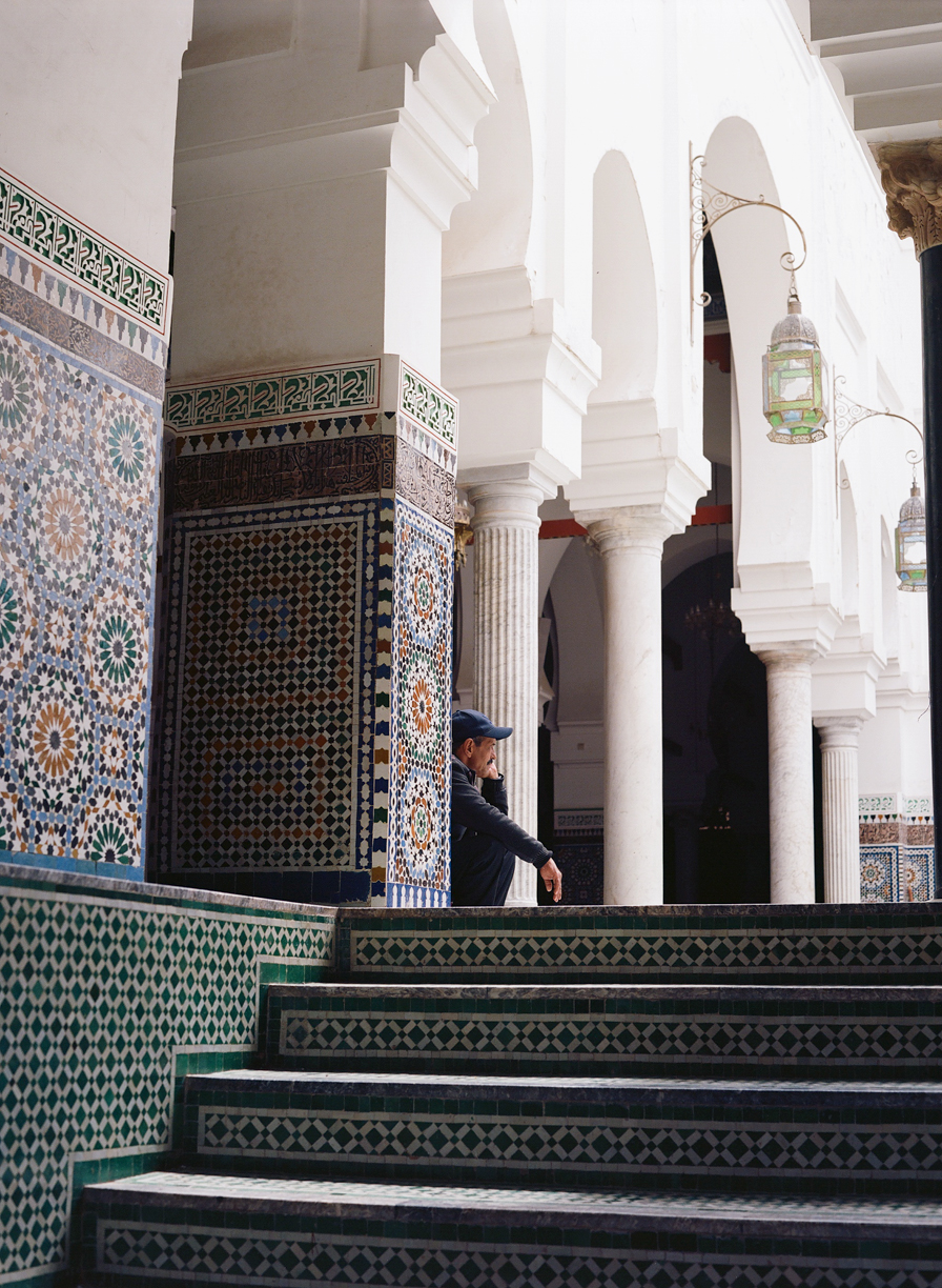 Man Seated on Tiled Floor Inside Mosque_Fez_web.jpg