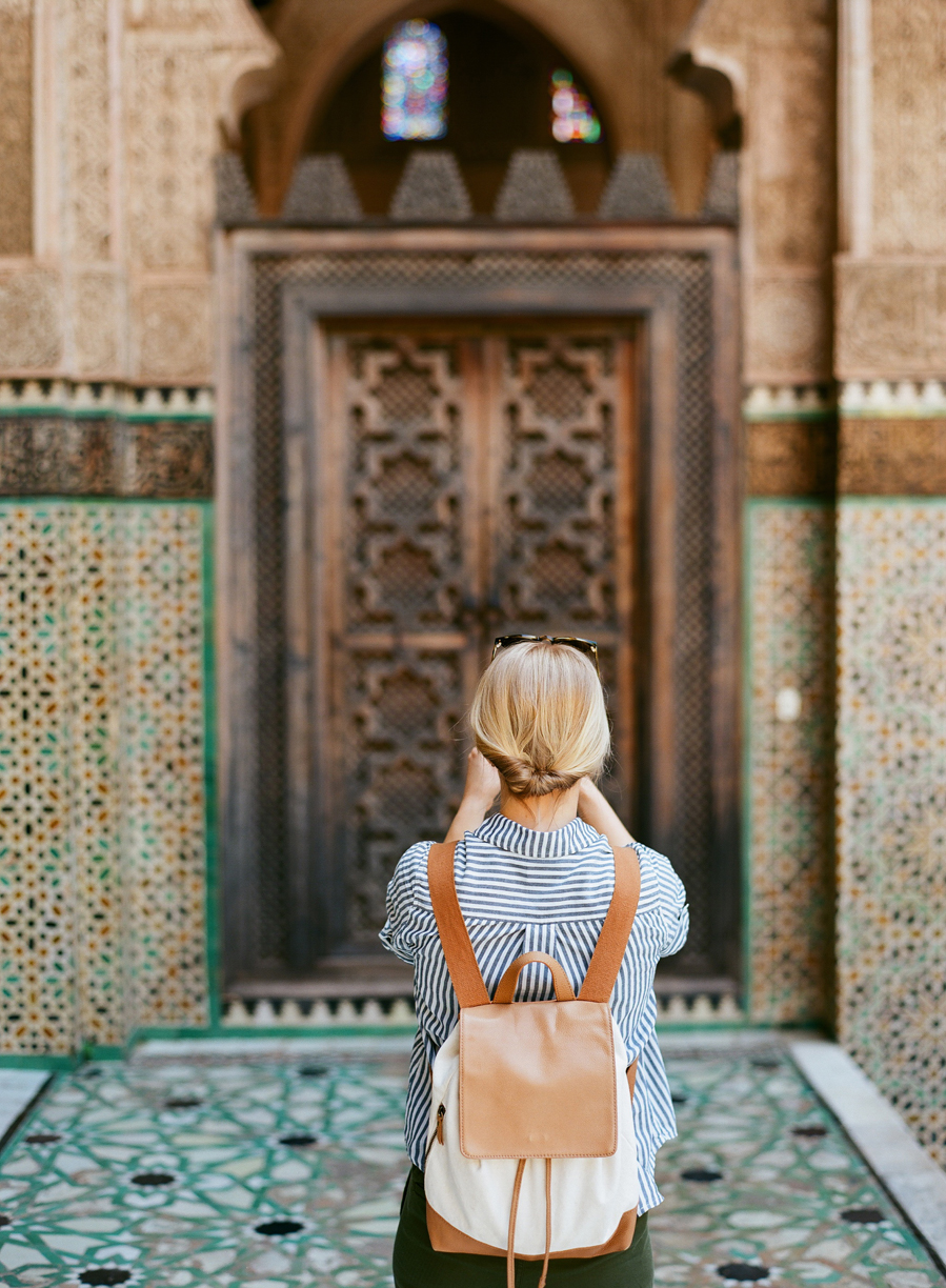 Allison Taking a Picture of Door Inside Mederssa El Bouanania_Fez Medina_web.jpg