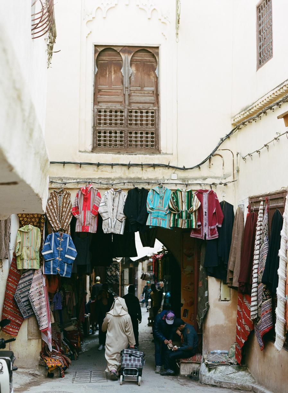 Man walking with cart in fez medina_web.jpg