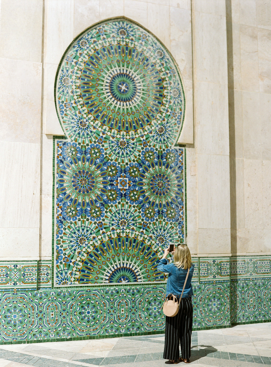 Allison taking an iphone pic of tiled wall_hassan mosque II_web.jpg