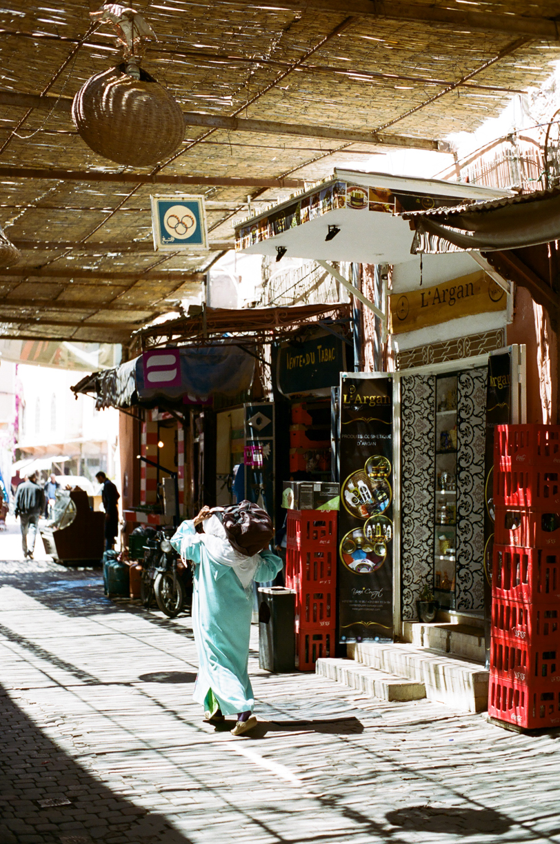 Woman Carrying Bag on Shoulder through medina_Marrakech_web.jpg