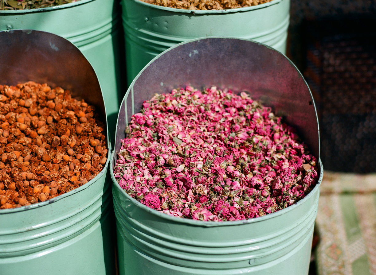 Dried Rose Pink Flower Petals inside teal metal bin_Marrakech_web.jpg