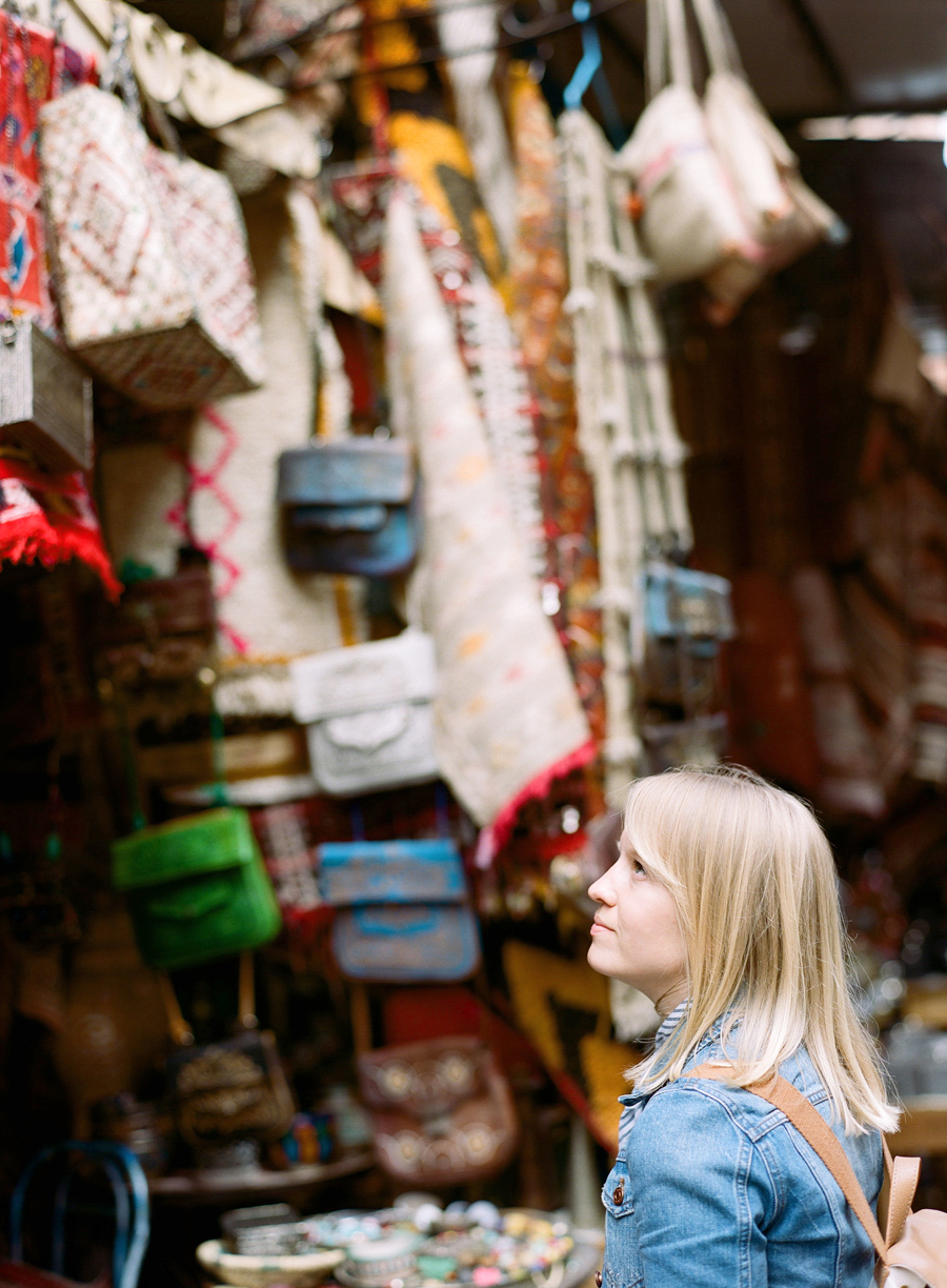 Allison Looking Up at Bags in market inside Marrakech medina_web.jpg