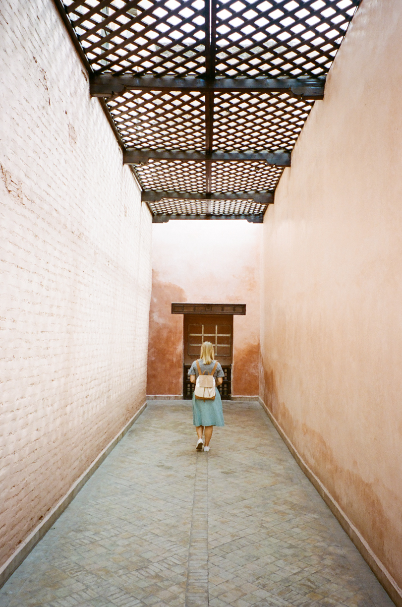 Allison Walking in Pink Hallway to Saadian Tombs_Marrakech_web.jpg