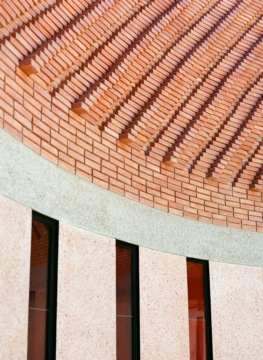 Curve in Exterior Wall of YSL Museum_3 windows and brick work_web.jpg