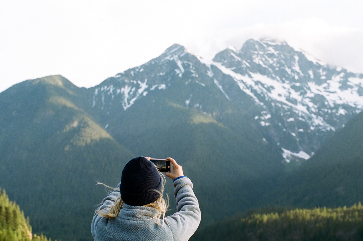 Allison Taking an iPhone Picture of Cascade Mountains_Diablo Lake_web.jpg