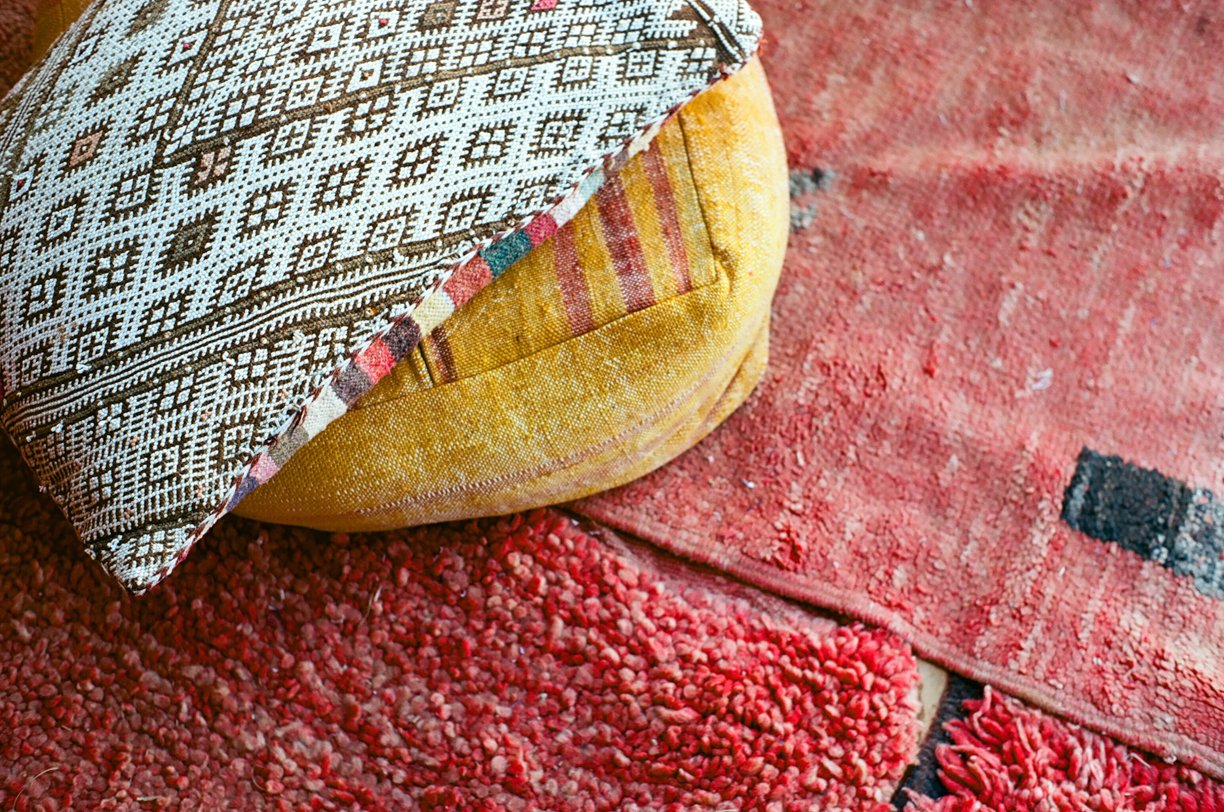 Pillows and red rug by tent_sahara luxury desert camp_web.jpg