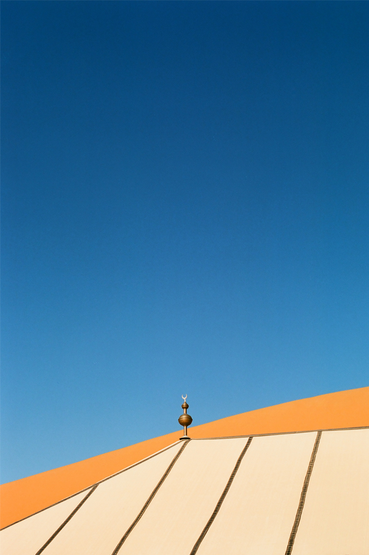 Yellow Circular Ball and Crescent Moon on Point of Tent_Sahara Desert Luxury Camp_web.jpg