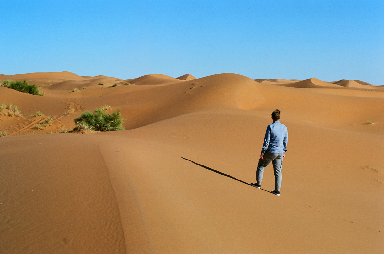 Cole Looking out at the dunes in the sahara desert_from behind_web.jpg