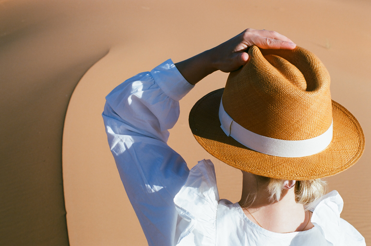 Allison in Focus Holding Hat_Curve in the sand_Sahara Desert_web.jpg