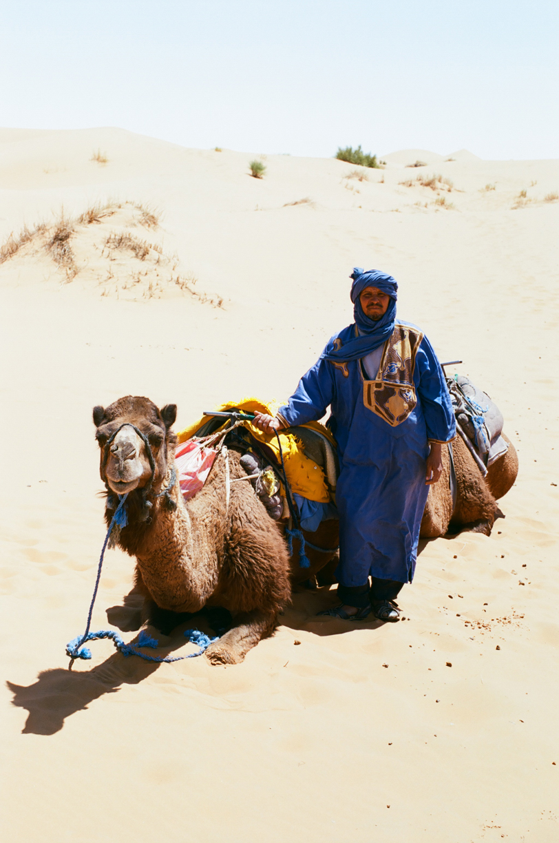 Camel Guide with Seated Camel in Sand_web.jpg
