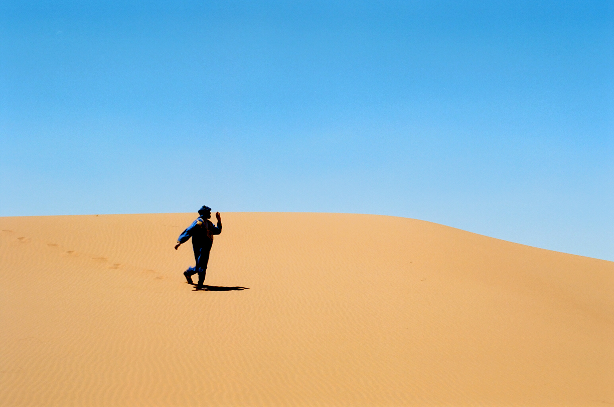Camel Guide Walking down dune_Sahara_web.jpg