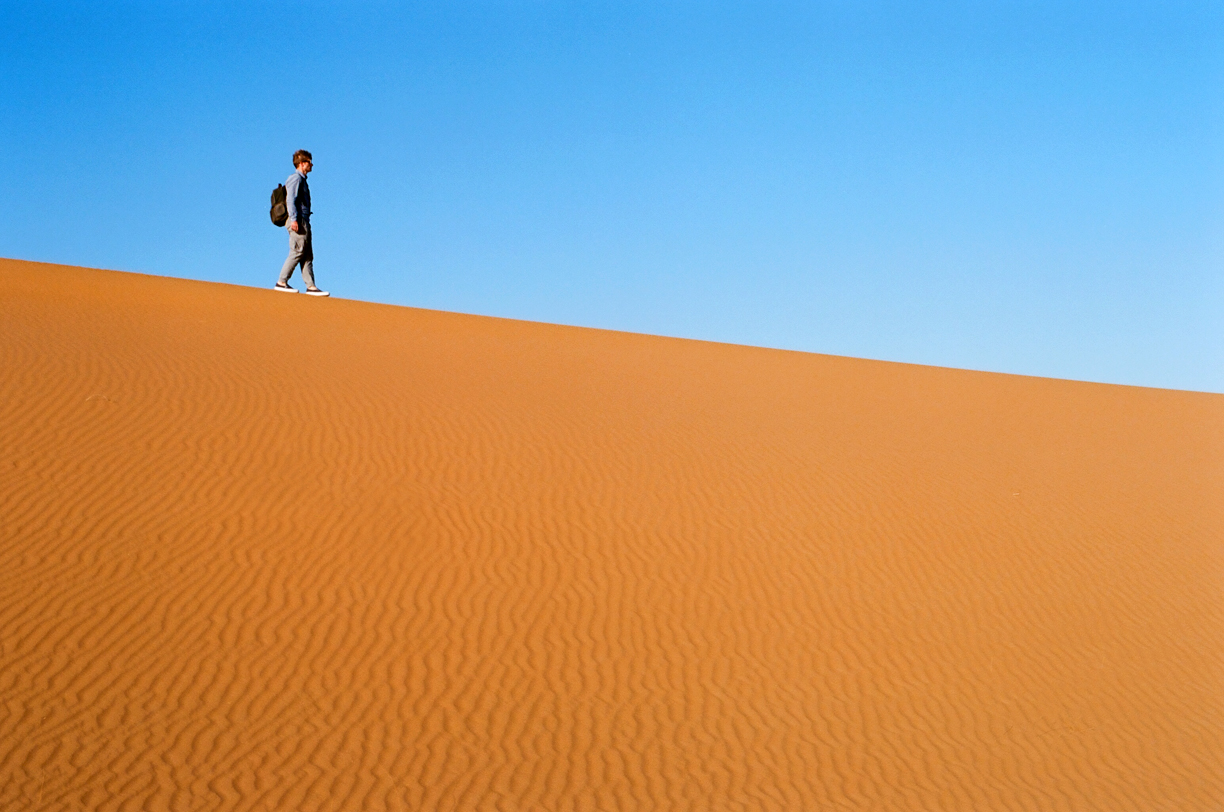 Cole Walking on Edge of Dune Line_Sahara Desert_web.jpg