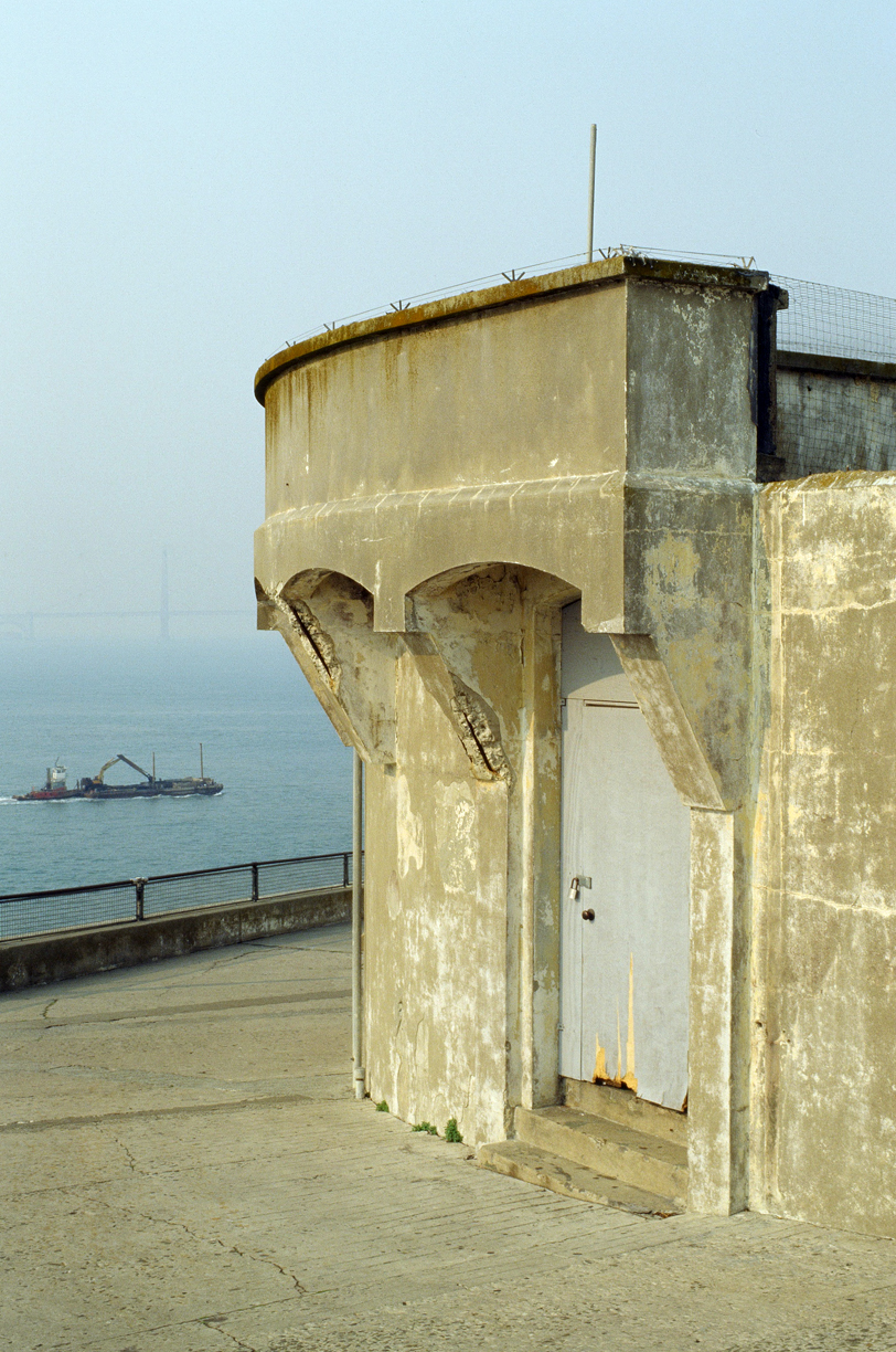 Pillar near lighthouse_barge in ocean and bridge_alcatraz_web.jpg