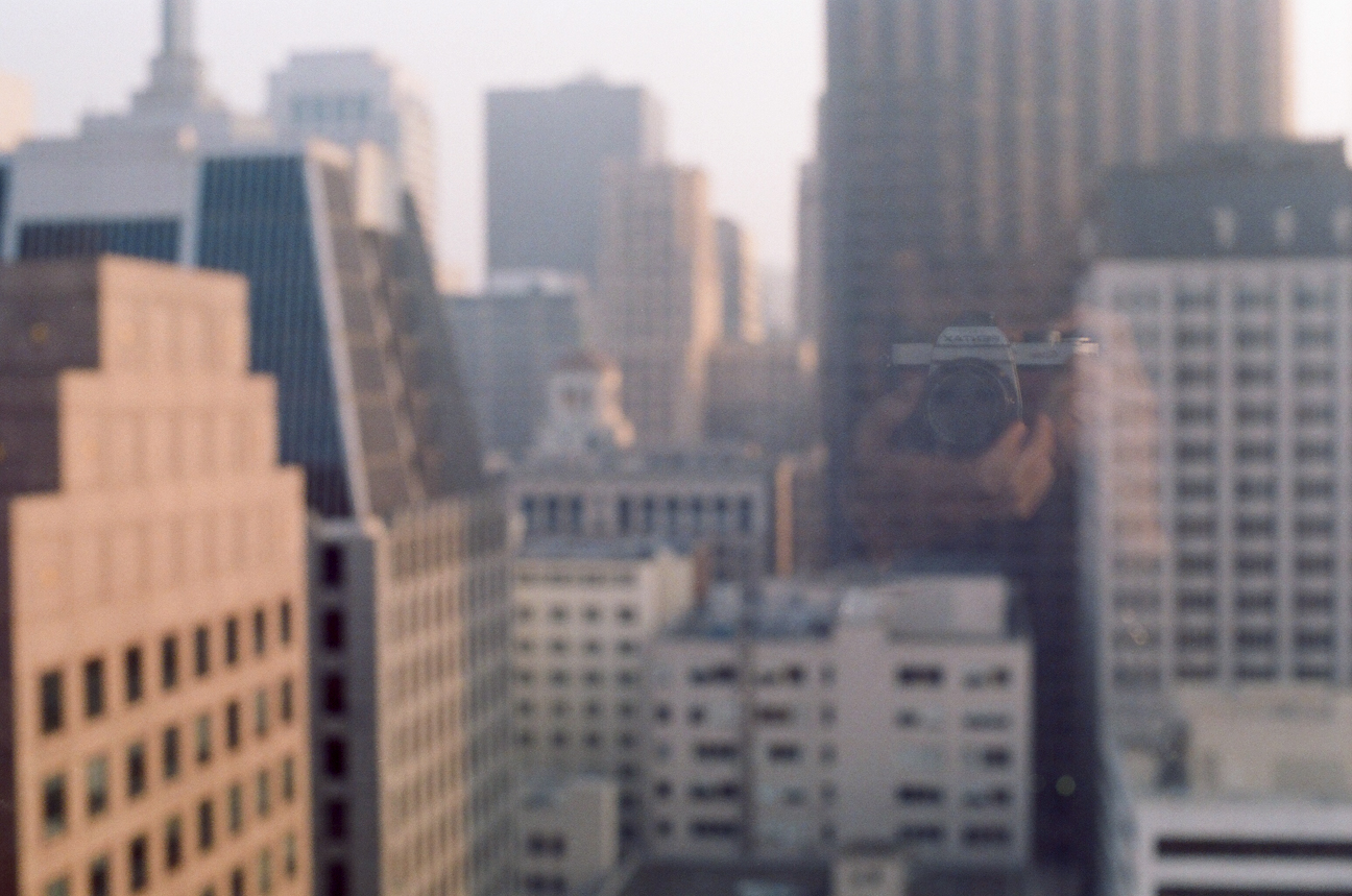 Selfie in the glass window of hotel room_San Fran Buildings in financial district_web.jpg