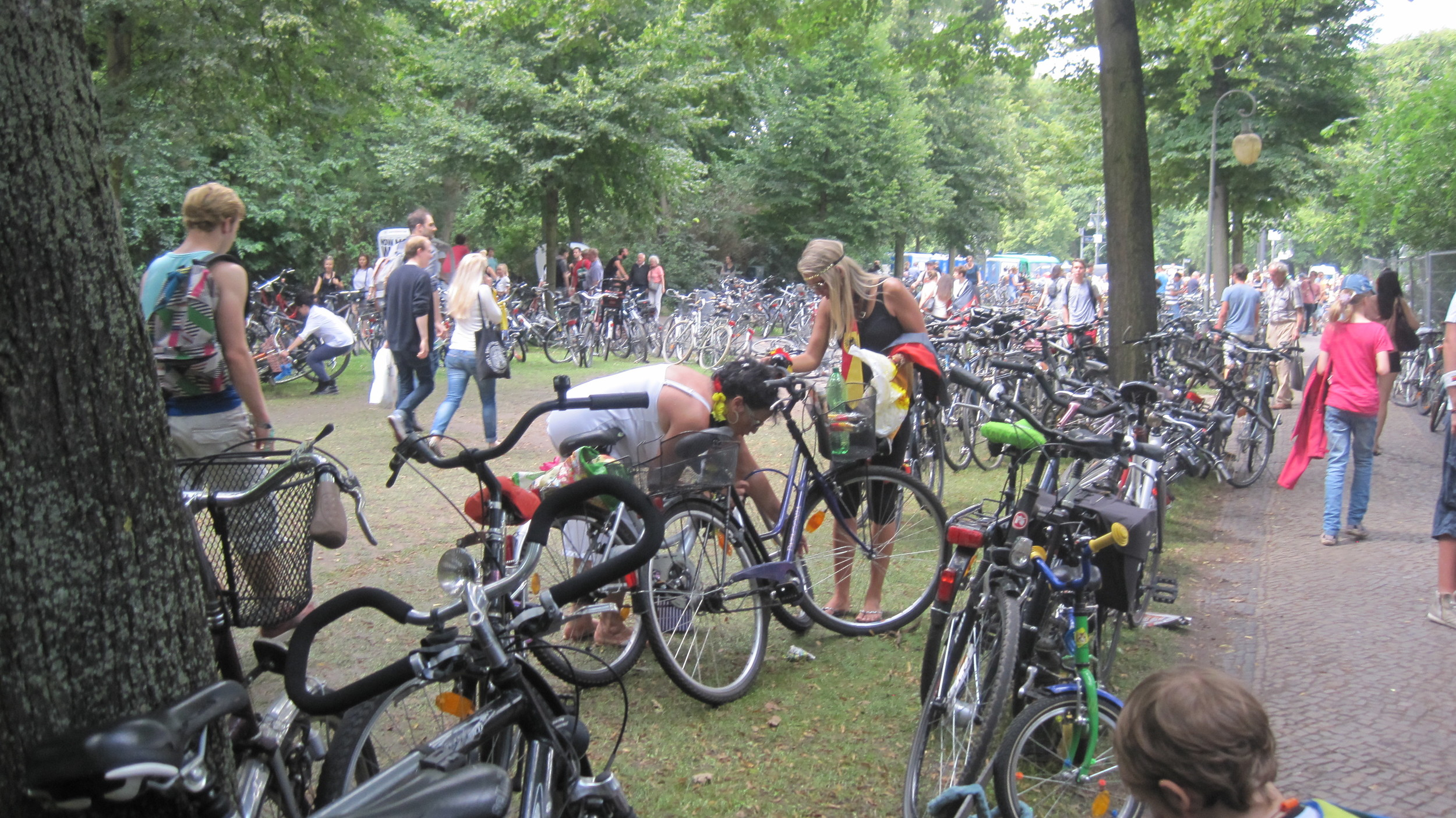 Germany soccer fanscame by foot, bike and transit to join in the massive World Cup celebration at Bradenburg Tor. It was an amazing time to be in Berlinto see soccer mania and the prevalent use of bikes across the city. (Photo: M. Zimmerman, July 2014)