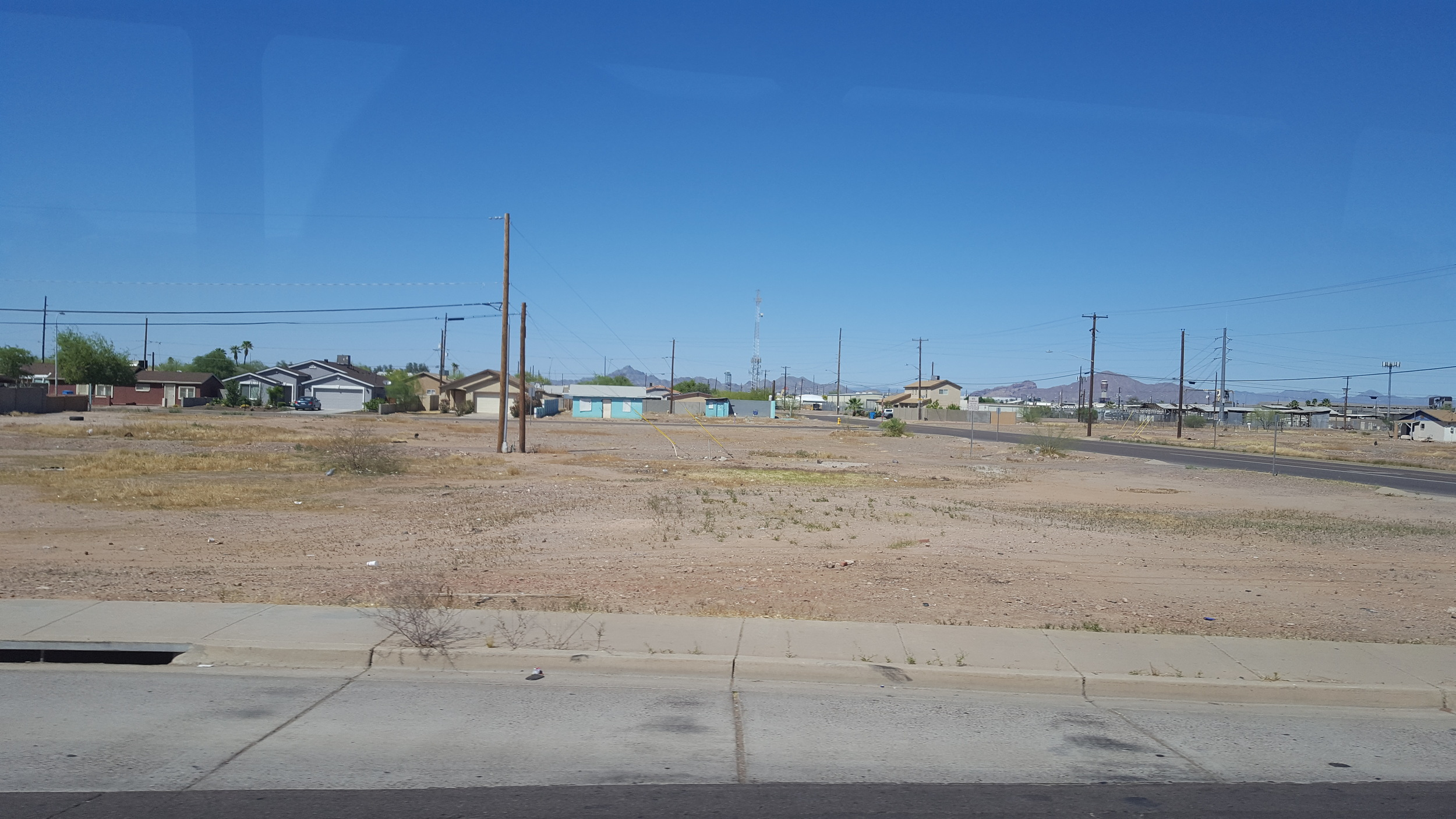 This brownfield site was contaminated by a South Phoenix hazmat fire several years ago. The neighborhood continues to be plagued by hazmat fires adjacent to housing causing significant public health concerns and development challenges. (Photo: M. Zimmerman, April 2016)