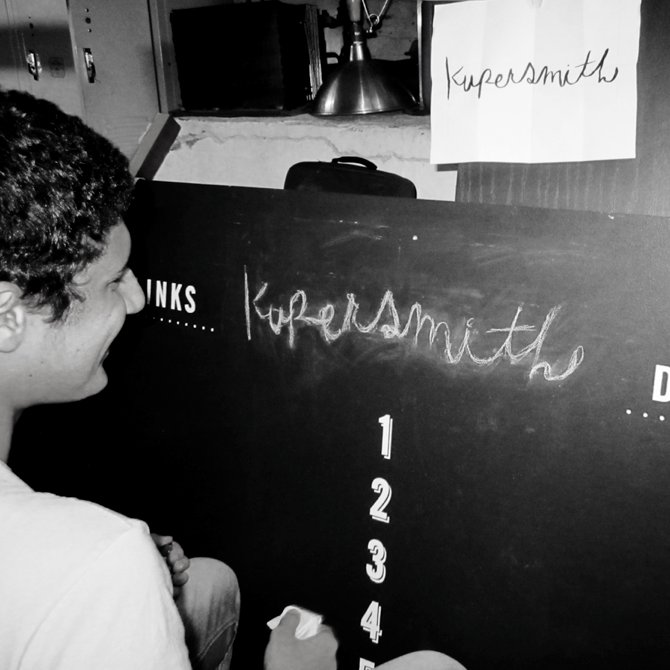 Kupersmith  by 21thru24 Pedro getting hands on while apply the logo to a piece of signage for Kupersmith a Restaurant bar on the lower east side.
