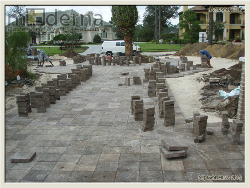 Laying out the field pavers,preparingto set the double soldier course.