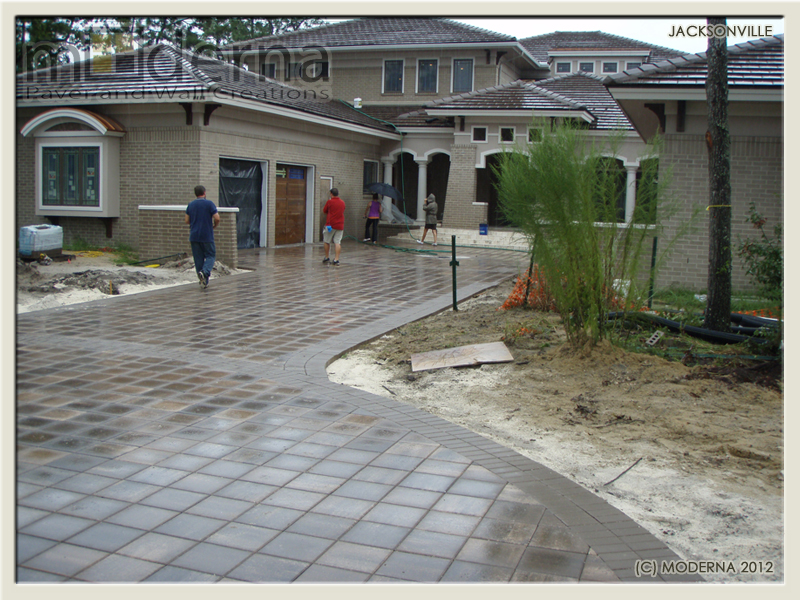 The pavers are rinsed as the final details are being completed.