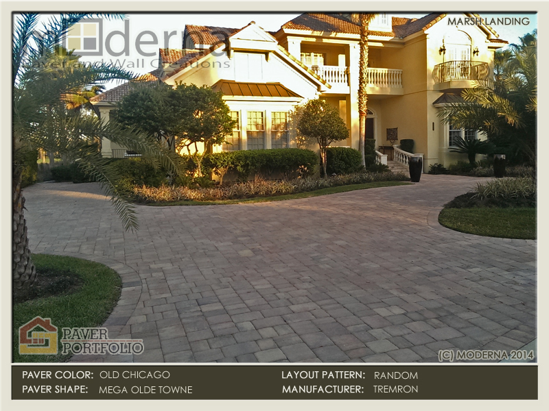 The finished circular brick paver driveway, complete with new landscaping.