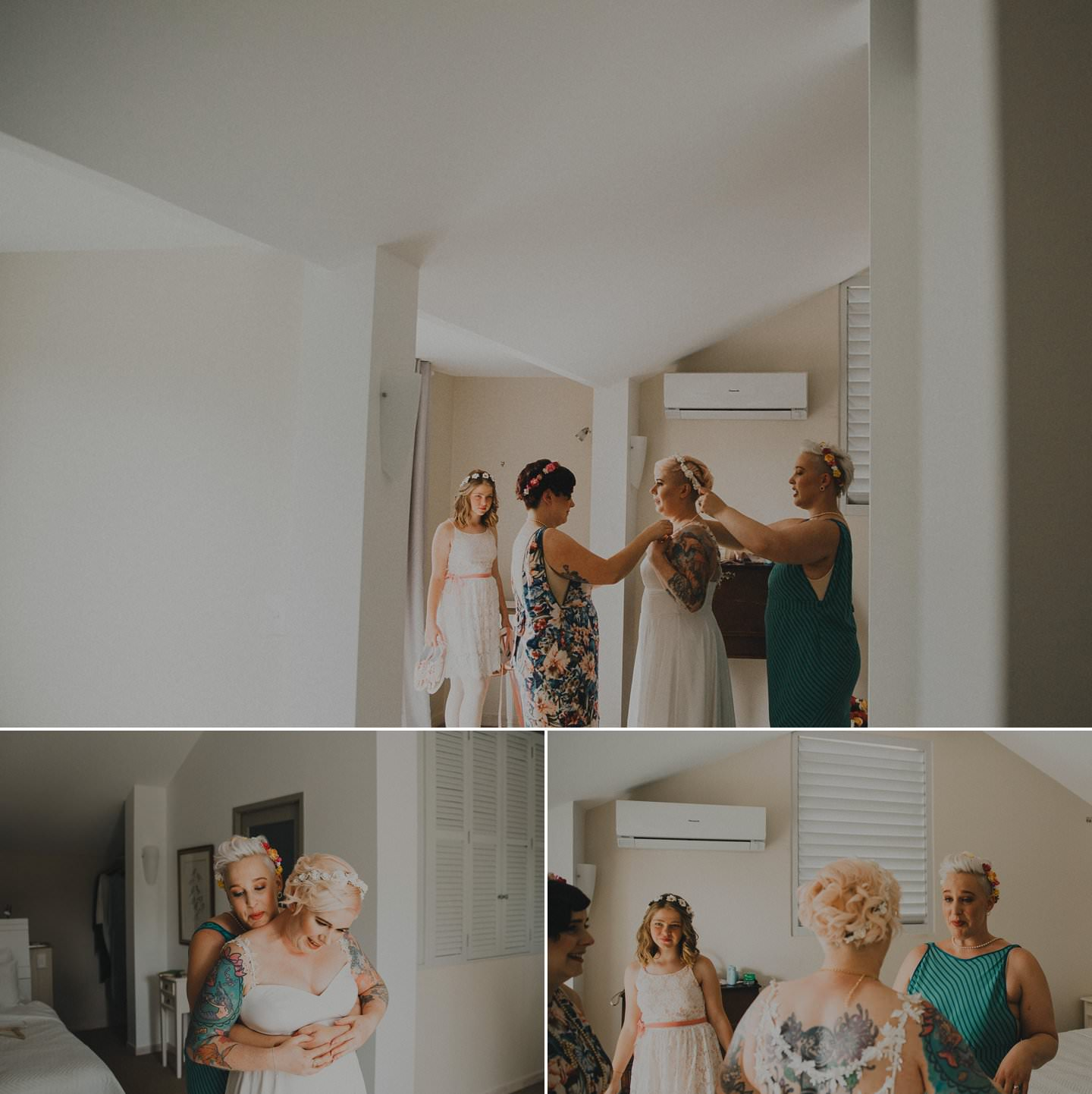 Alternative bride with pink hair and tattoos getting ready with bridesmaids
