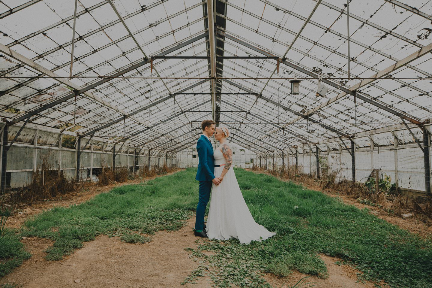 Hispter wedding with alternative couple in a glasshouse