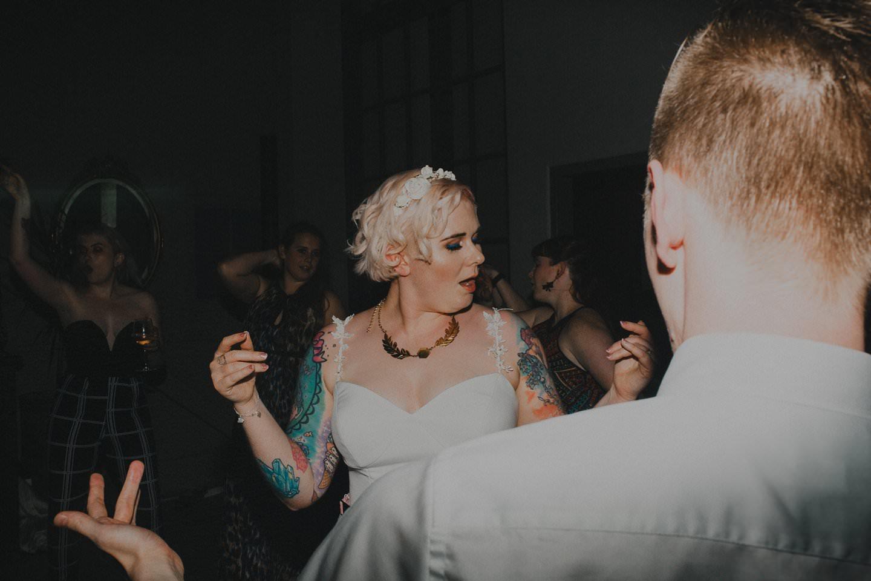 Tattooed bride dancing