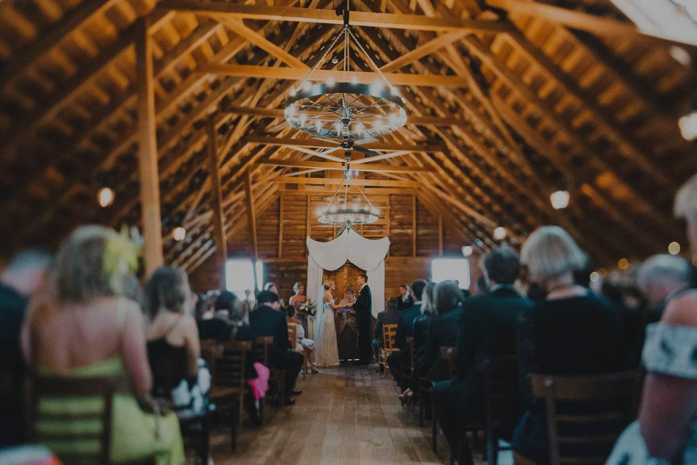 Wedding ceremony in rustic barn New Zealand