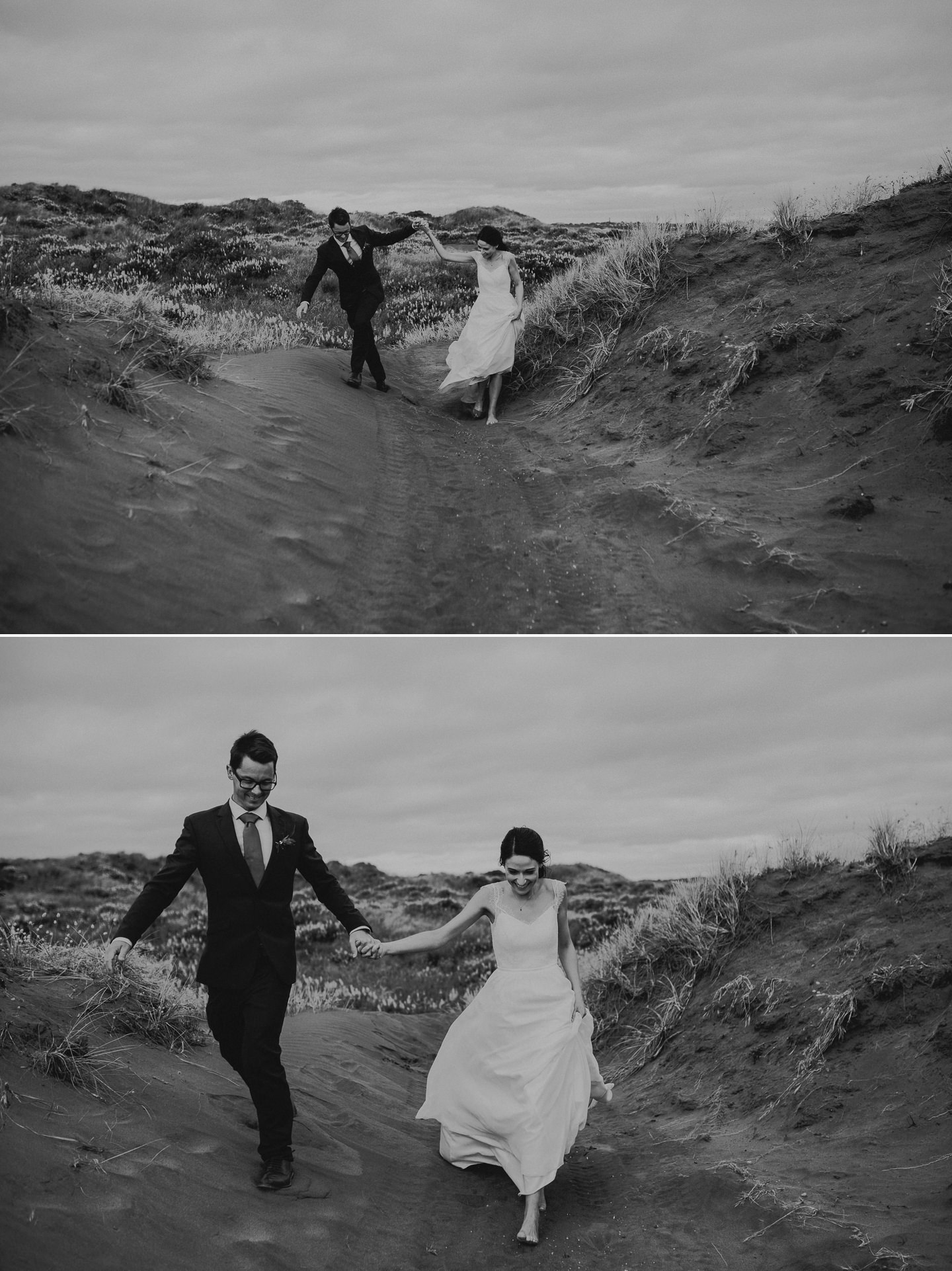 Bride and groom playing on sand dunes