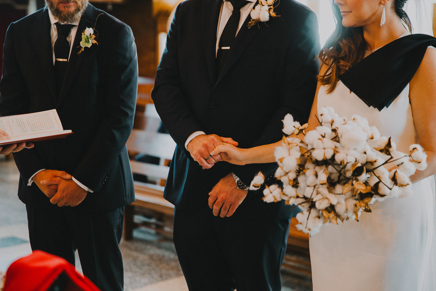 The birde and groom holding hands during the wedding ceremony