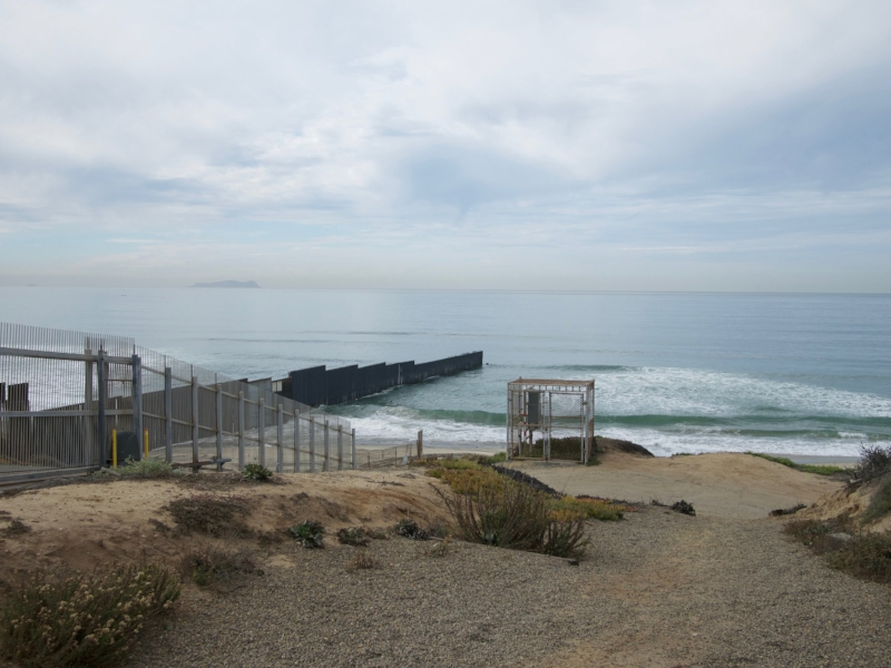 looking at the border fence going into the pacific ocean
