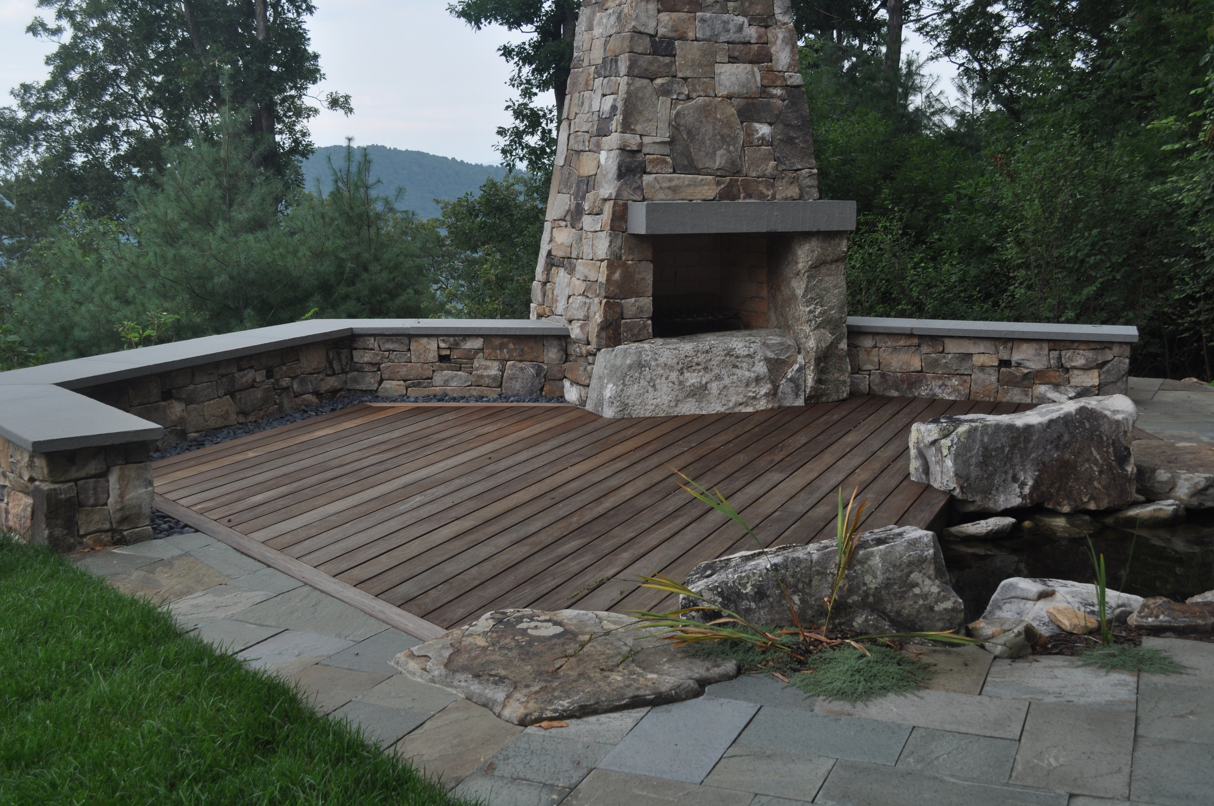 Boone/Jamison Residence, Lower Deck by outdoor fire place and pond.
