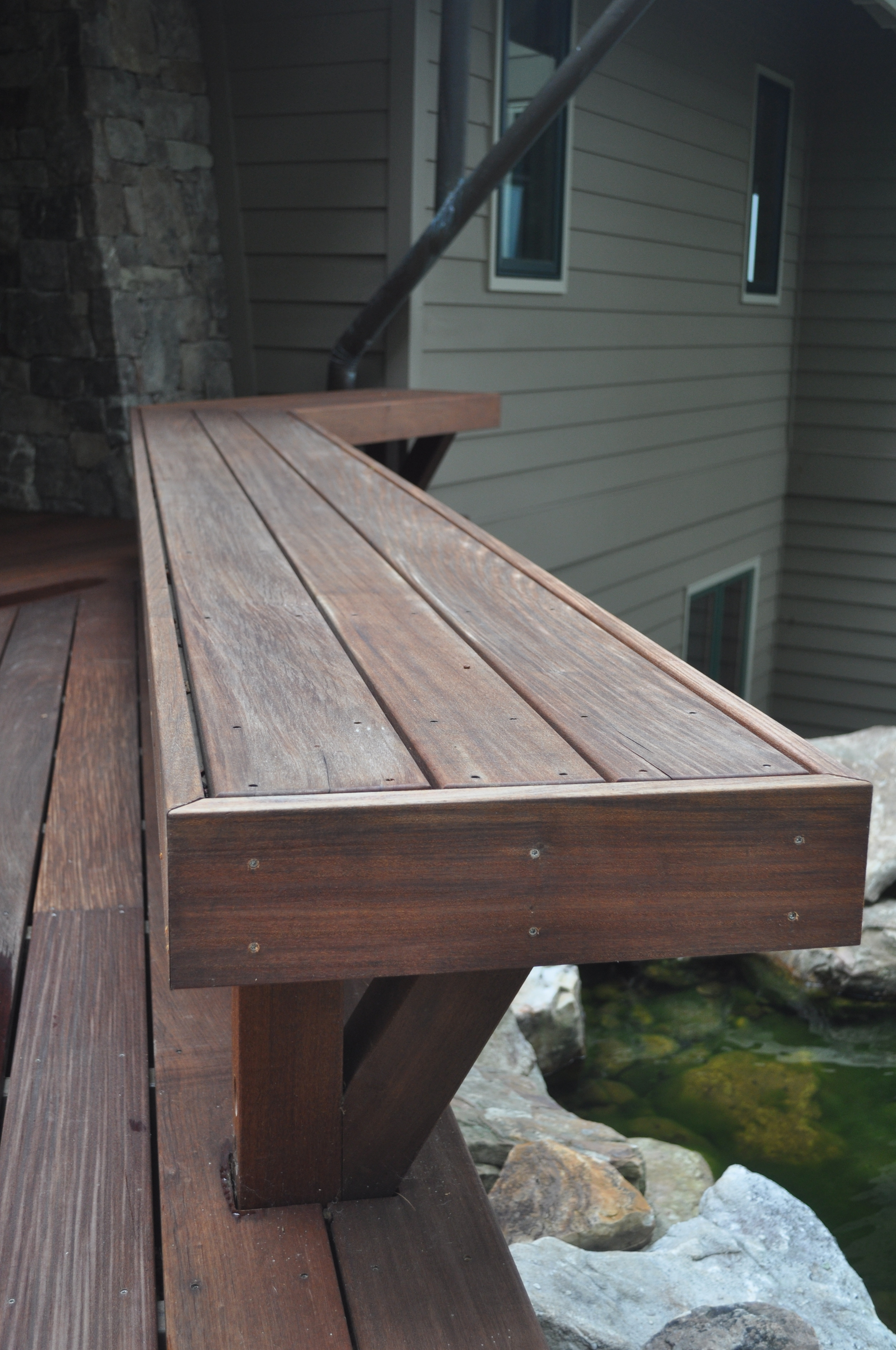 Boone/Jamison Residence, Detail of bench located on the catwalk deck that leads to front entry .