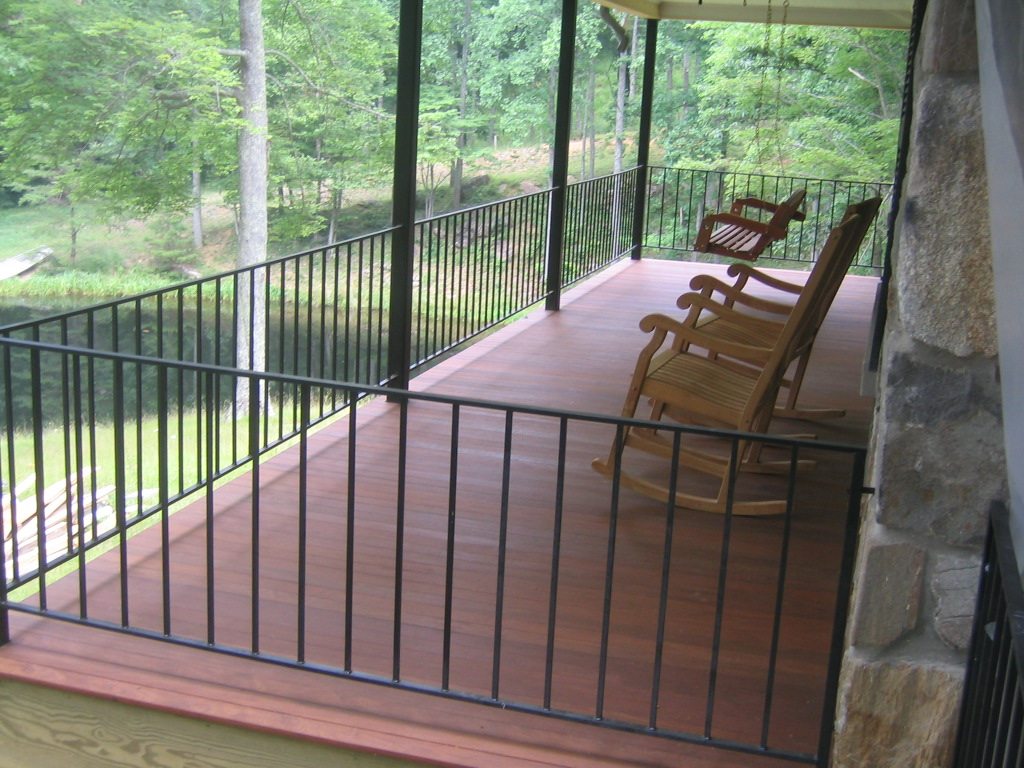 Sofa Rock Residence, Covered side porch with tongue and groove Ipe flooring.