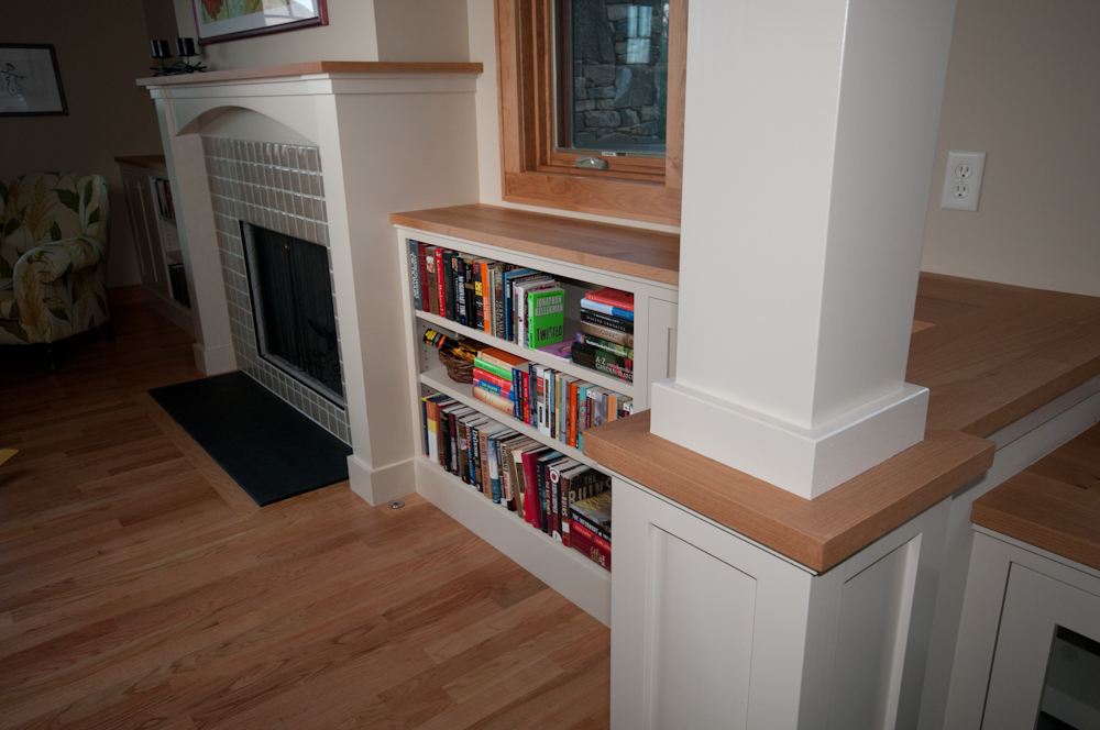 Bookshelves that Flank Fireplace. Painted poplar bookshelves, painted poplar fireplace surround, painted poplar columns, hard maple tops, handmade ceramic tile around fireplace, and slate hearth.