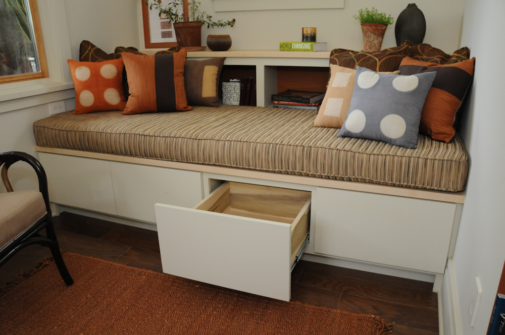 Daybed at Southern Living Idea Home Davidson Gap.  A comfortable spot for reading or napping with storage underneath. Painted poplar with hard maple tops.