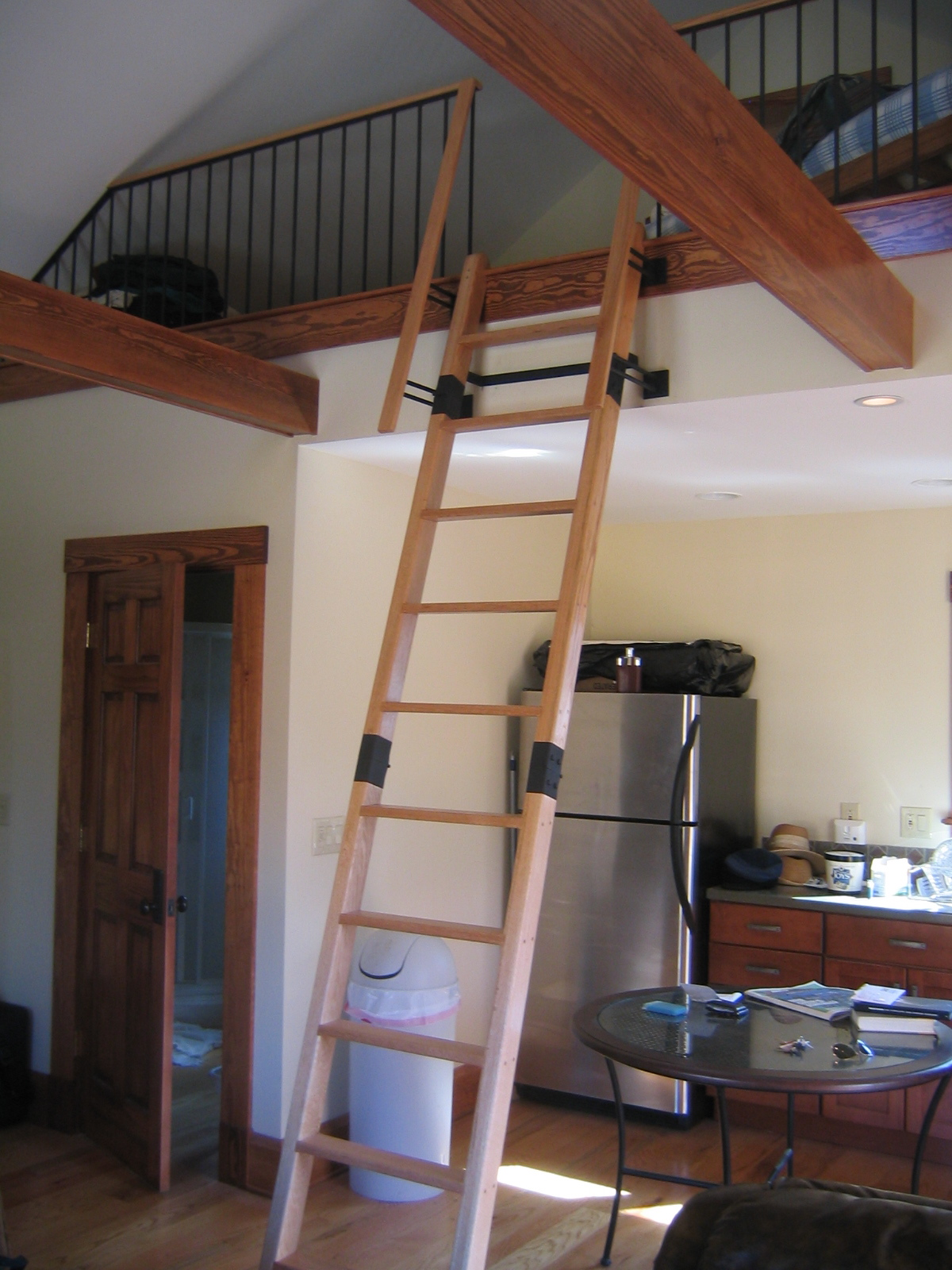 Folding Ladder and Railing. This oak ladder is truly one of a kind. The brackets that hold if flow right into the handrail above.  Breitzke Carpentry  Designed and built every component of this system. Oak and painted steel.