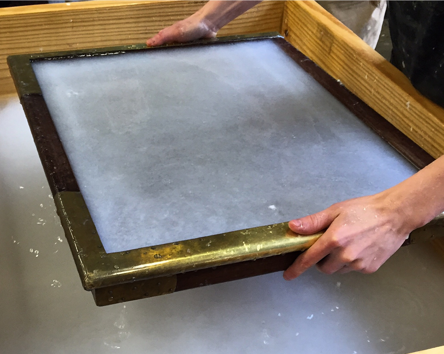 Rachael making cotton rag paper, using the most beautiful mold.
