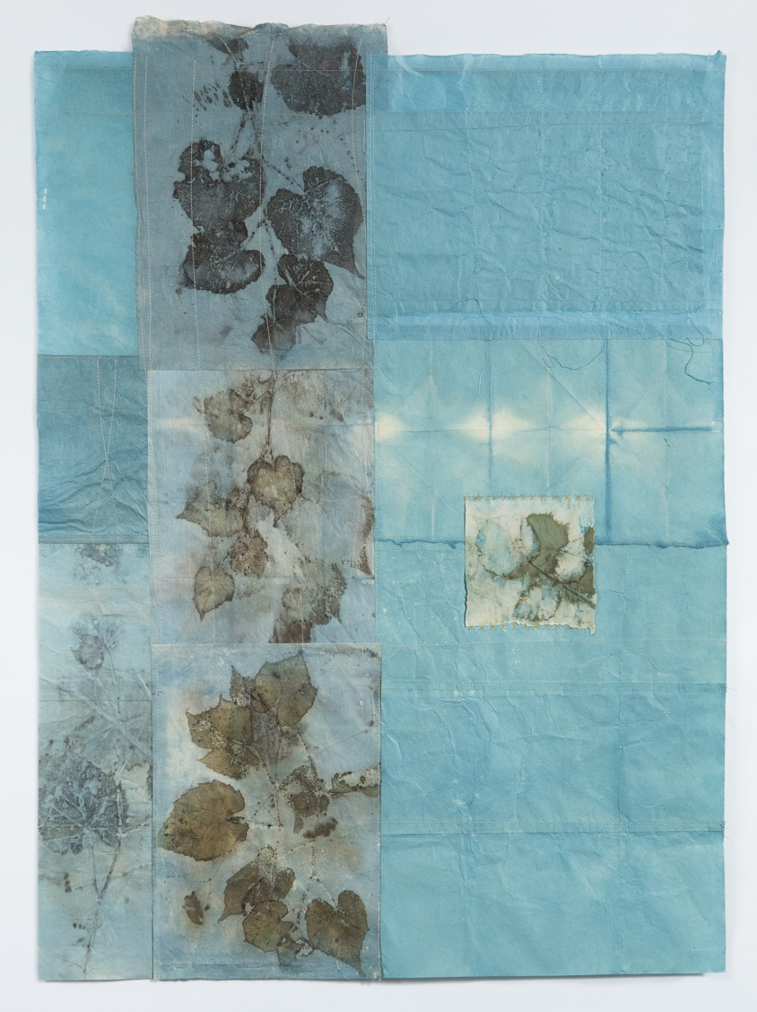 """Disintegration , by Lotta Helleberg, 2017, Japanese mulberry paper, Strathmore printing paper, indigo dye, and botanical contact prints, hand and machine stitching, 34"""" x 25"""""""