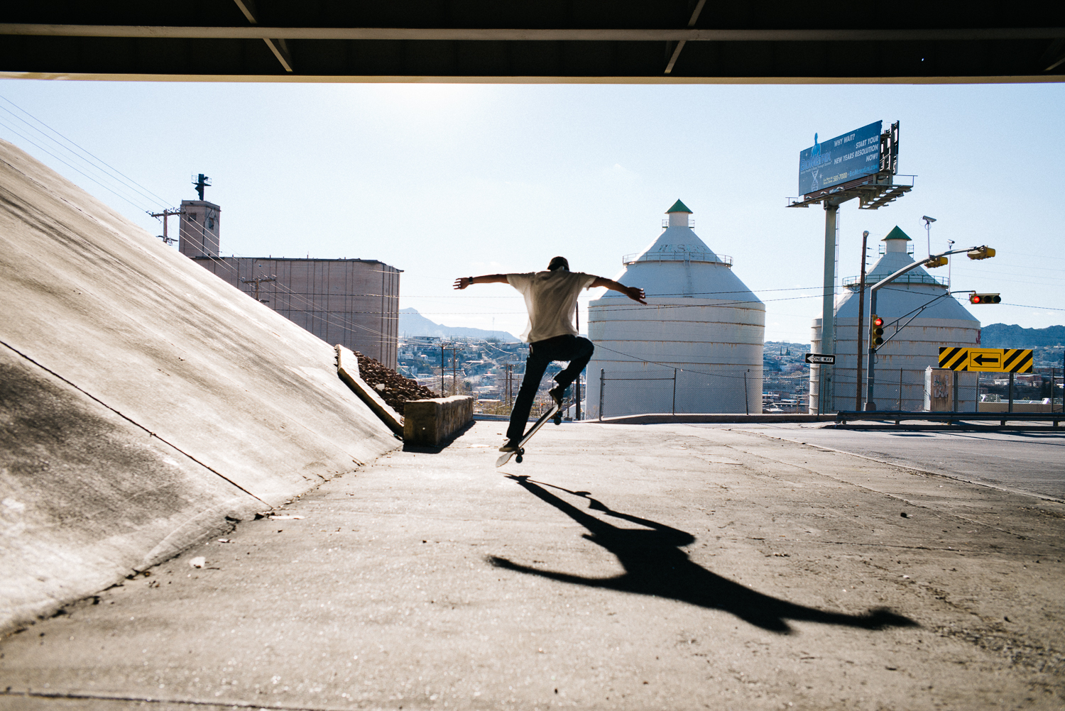 My brother Ben skating under the I-10 freeway facing into Juarez, Mexico.  Michael Lim Photography 2015 ©