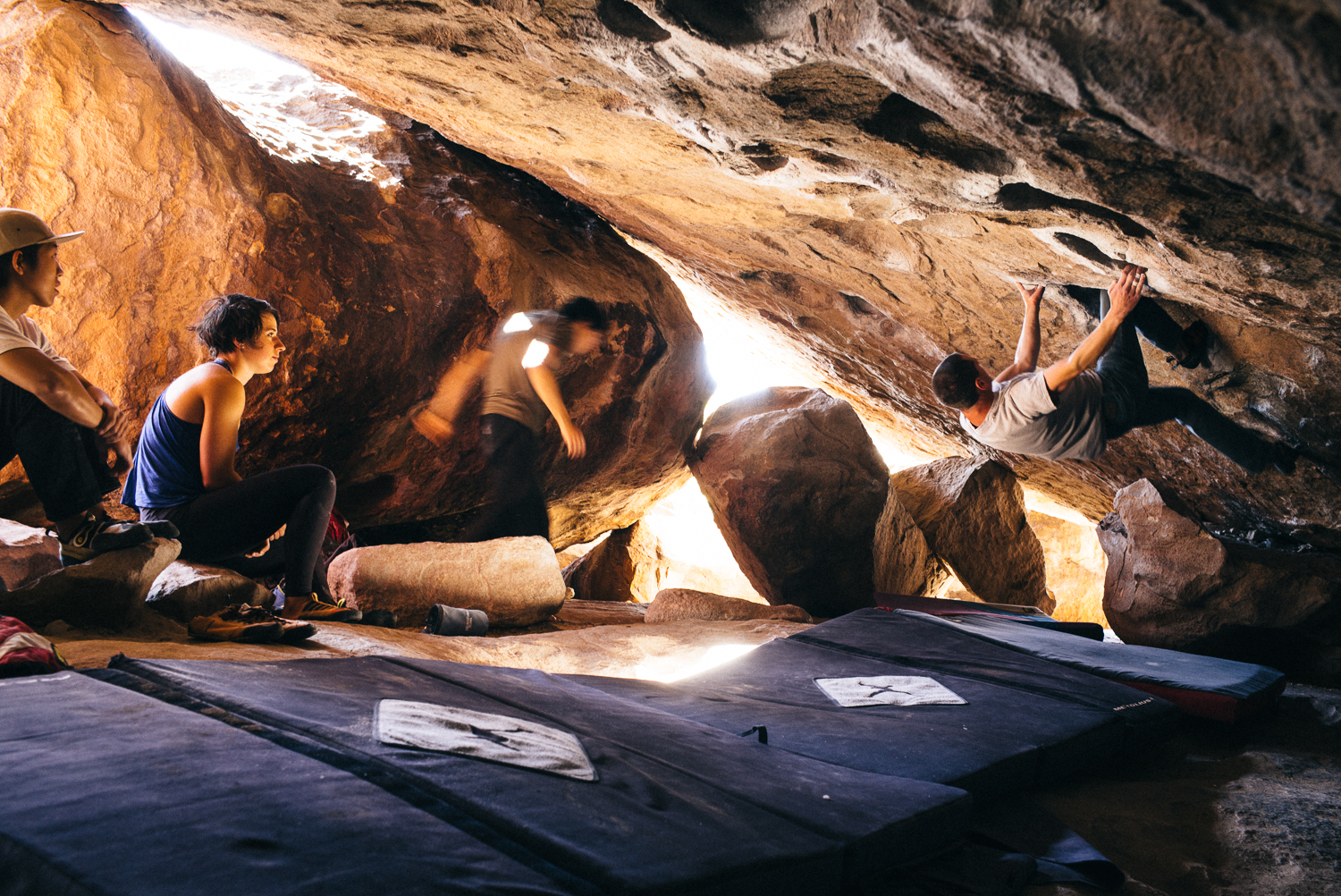 Alex finishing (sending) Martini, a V4 roof problem in a cave of Hueco Tanks, Texas. Pictured left to right: Ben Lim, Caitlin Wolters, Alex Lin, and Jeff Miller. Michael Lim Photography 2015 ©