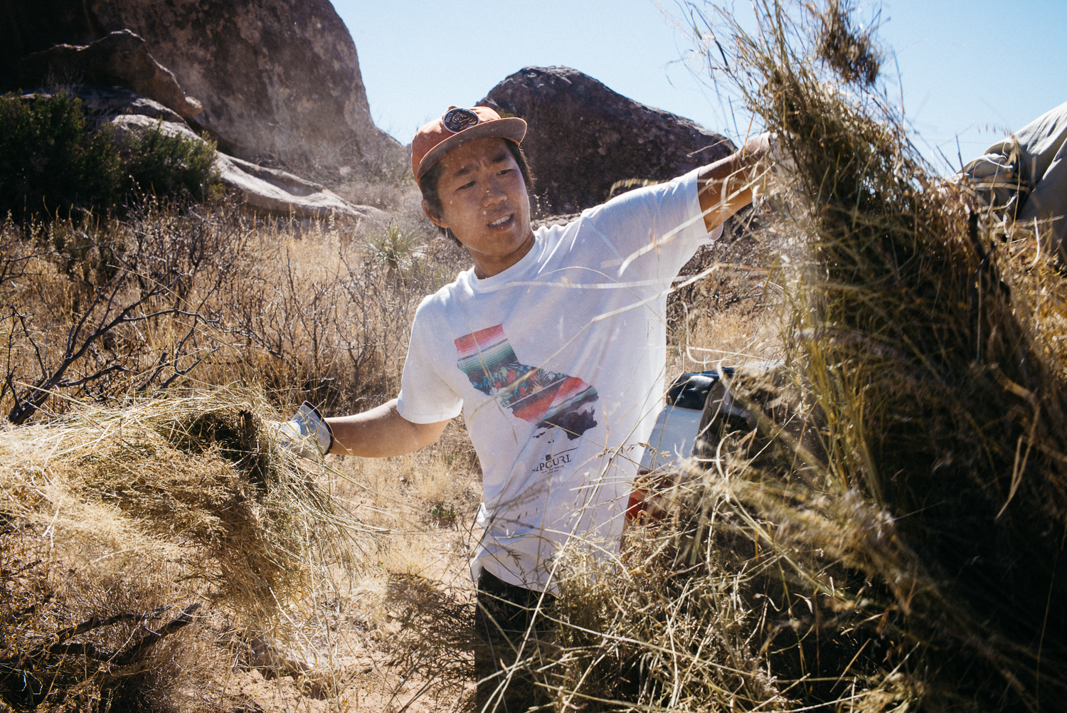 Ben Lim picking up hay as a volunteer with the Access Fundand placing it down after the gravel removal to help mitigate erosion. Michael Lim Photography 2015 ©