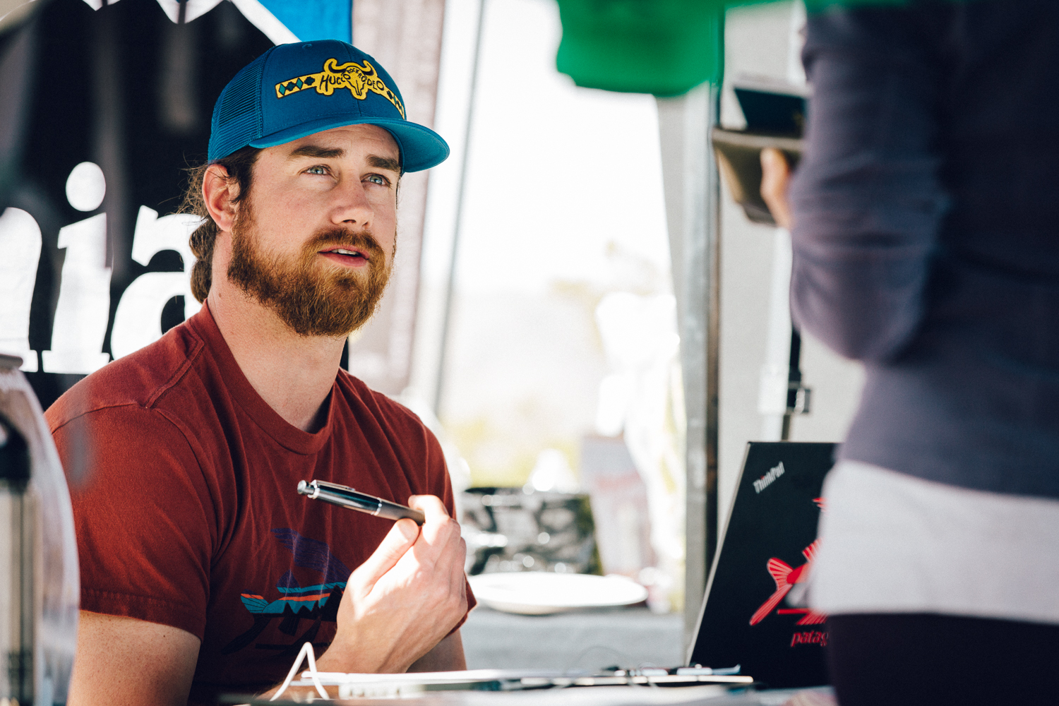 Zach Barker working at the Patagonia Sponsor's booth at the 2015 Rock Rodeo. Michael Lim Photography 2015 ©